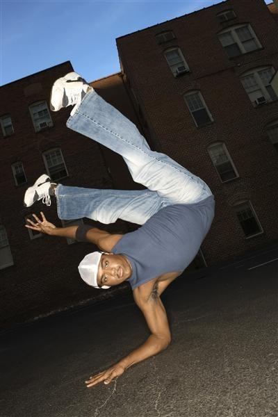 Break-dancer balancing on one hand