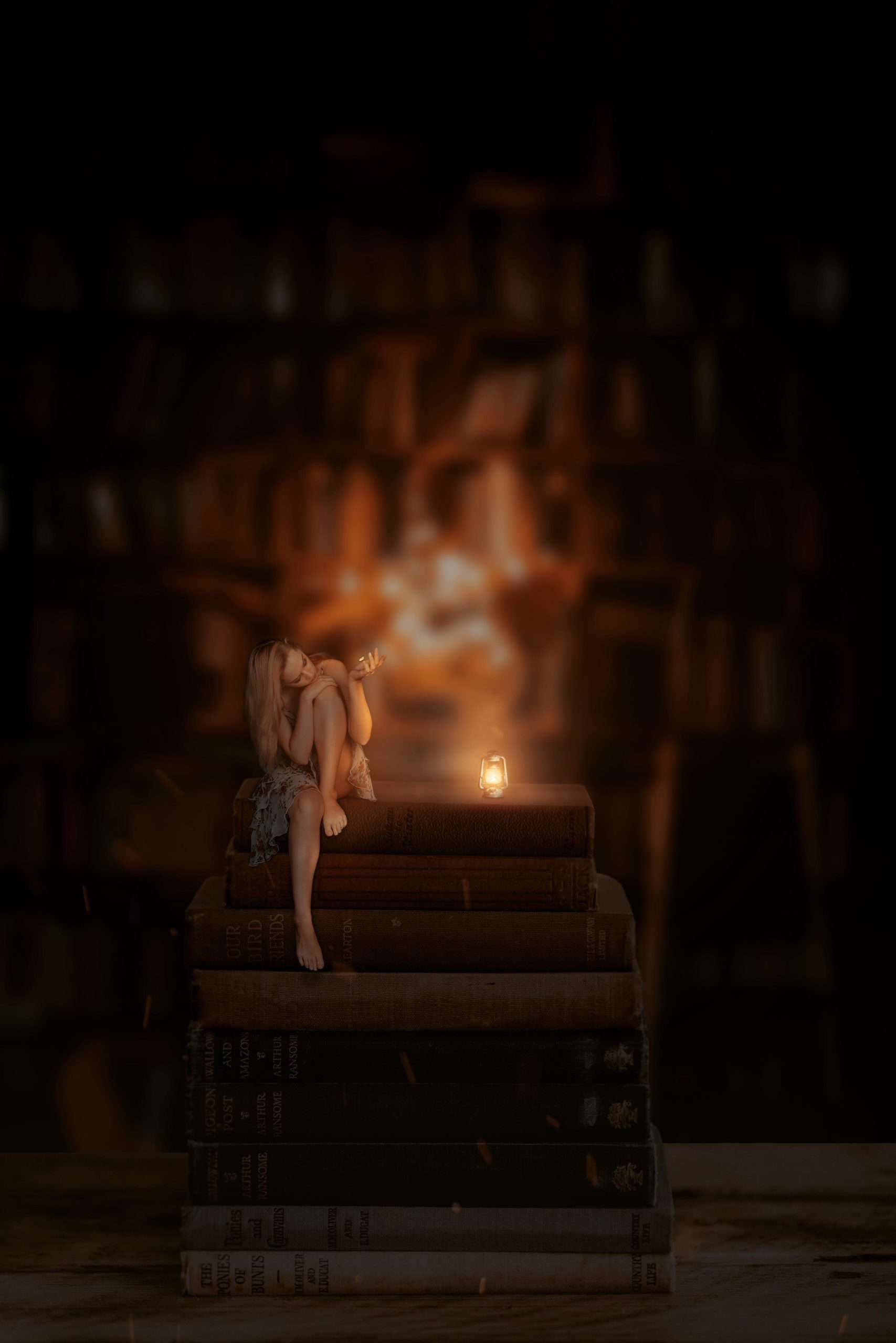 Create a Scene of a Fairy Sitting on a Stack Books in Photoshop